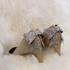 Nude Jeweled Bow Pumps